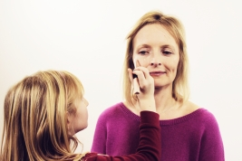 Grace applying concealer