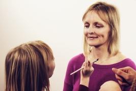 Grace applying lip gloss